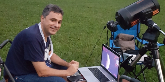 RASC volunteer at an evening star party
